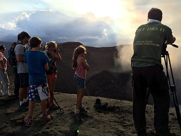 Kids on edge of volcano