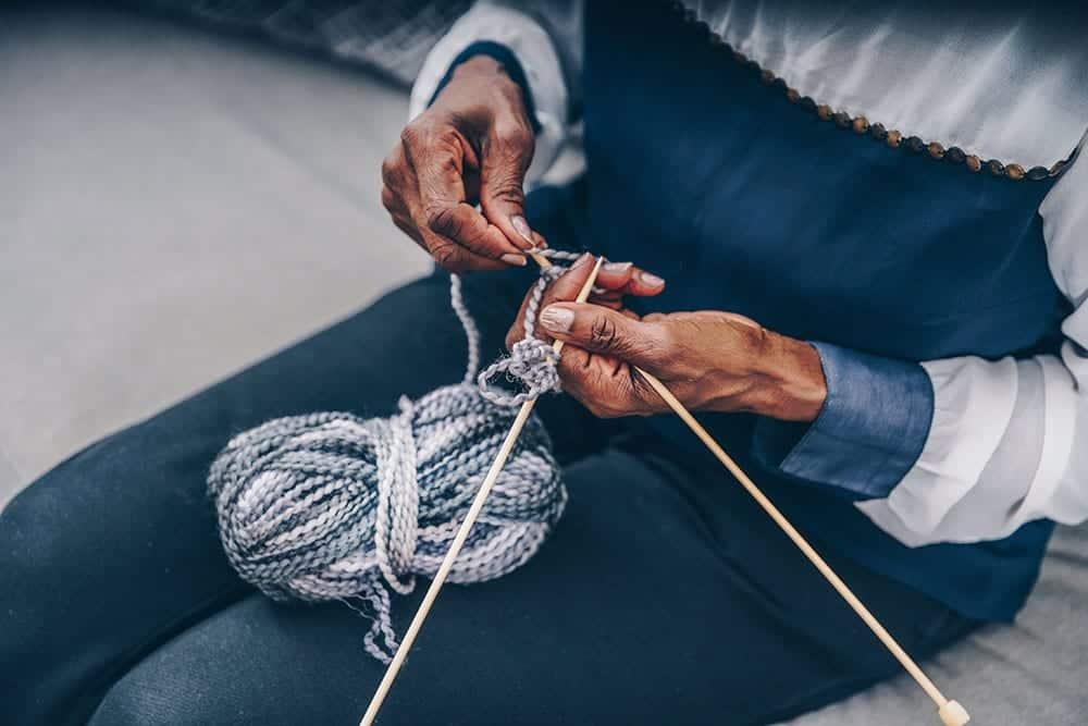 Lady knitting on a long flight