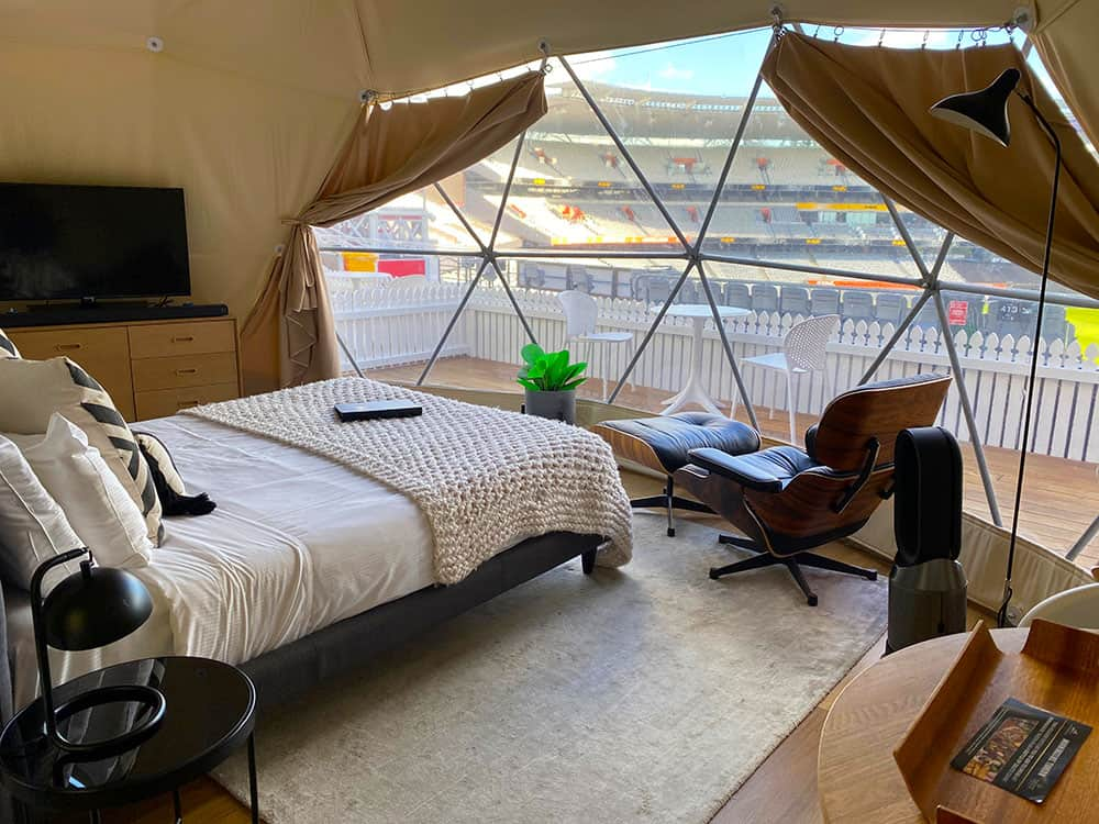 View of bed and stadium in glamping pod