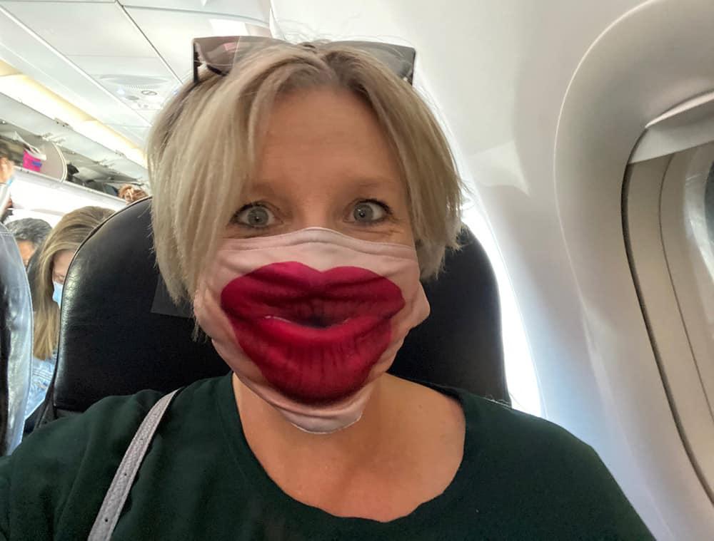 Megan in face mask on plane