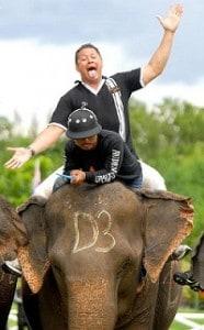 Charles Riechelmann rides an elephant